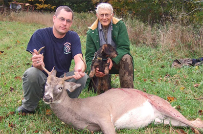 Justin Crosier with the deer, which was recovered by Tommy and his handler John Jeanneney